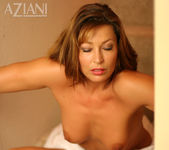 Alischa - mature woman on the stairs with her dildo 14