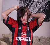 Autumn Riley strips out of a soccer jersey 3