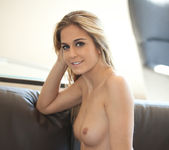Blonde beauty Cassidy Cole strips out her her clothing 10
