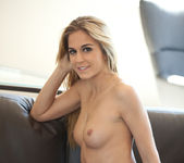 Blonde beauty Cassidy Cole strips out her her clothing 11