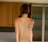 Teen babe Hailey Leigh gets naked on the counter top 12