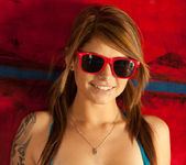 Busty teen babe Hailey Leigh poses with sexy red sunglasses 2