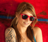 Busty teen babe Hailey Leigh poses with sexy red sunglasses 6