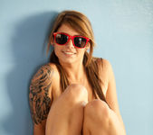 Busty teen babe Hailey Leigh poses with sexy red sunglasses 13