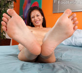 Young Ariana Fox Gives Footjob and Sucks Cock 6