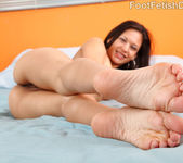 Young Ariana Fox Gives Footjob and Sucks Cock 7