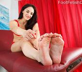 Sheena Ryder Wraps Her Sexy Feet Around a Black Cock 2