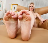 Skylar teases a cock with her sexy feet 5