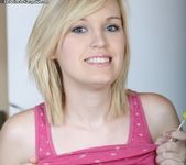 Amanda - blonde teen shows her pussy in the kitchen 2