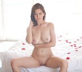 Chrissy Marie gets naked in bed full of rose petals 11