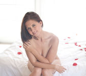 Chrissy Marie gets naked in bed full of rose petals 13