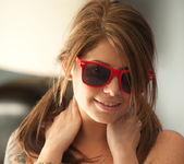 Teen babe Hailey Leigh in a sexy bedroom striptease 14