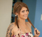 Cute teen babe Hailey Leigh flaunts her perky breasts 3