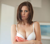Busty brunette Chrissy Marie strips out of a beautiful dress 10