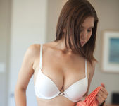 Busty brunette Chrissy Marie strips out of a beautiful dress 12