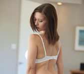 Busty brunette Chrissy Marie strips out of a beautiful dress 14