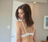 Busty brunette Chrissy Marie strips out of a beautiful dress 15