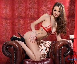 Emelia Paige teasing in the chair in sexy red lingerie