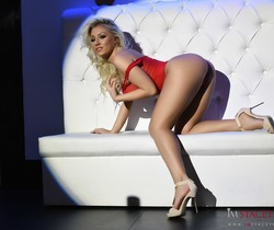 Stacey Robyn teasing in her sheer red bodysuit