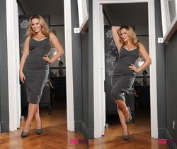Jodie Gasson teasing in her long grey dress in the doorway