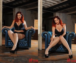 Lucy V seduces us on the blue chair, in her black bodysuit