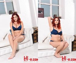 Lucy V teasing in her blue lingerie on the white sofa