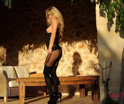 Rachel strips from her sexy black bodysuit and stockings
