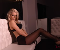Rachel McDonald strips from her black lingerie and stockings