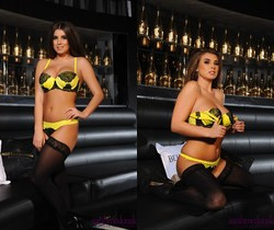 Sarah teases in her black and yellow lingerie on the couch
