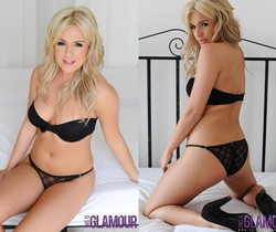 Amy teases in her black lingerie on the bed
