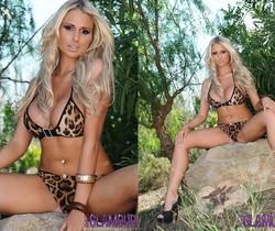 Cara Brett strips from her leopard print bikini