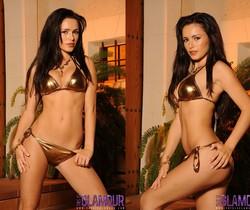 Gemma strips from her gold bikini