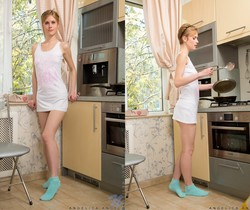 Angelica Angel spreading her pussy in the kitchen