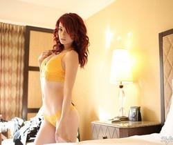 Kylie strips in her orange lingerie