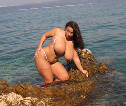 Aneta in mini Bikini on the beach - Aneta Buena