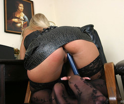 Inesin black corset and stockings masturbates with Dildo Blu
