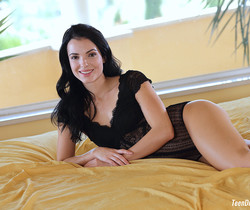 Sapphira A in Black Lace lingerie being naughty on the bed
