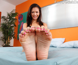 Young Ariana Fox Gives Footjob and Sucks Cock