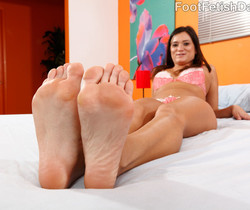 CeCe Stone Wraps Her Lips and Feet Around a Black Cock