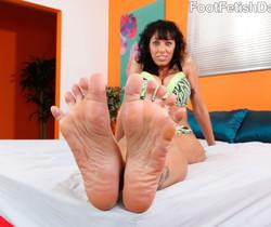 Alia Janine Wraps Her Pretty Feet Around a Hard Cock