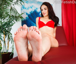 Sheena Ryder Wraps Her Sexy Feet Around a Black Cock