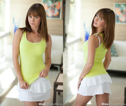 Cute brunette Chrissy Marie slips out of her skirt