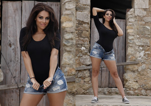 Charley in her black bodysuit and denim shorts