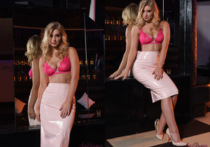 Jess Davies teases in her white skirt and pink lingerie top