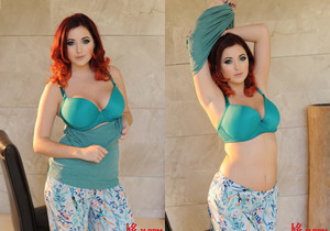 Lucy V teasing in green lingerie outdoors