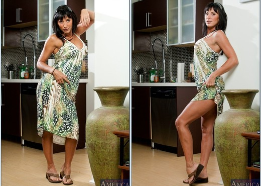 Busty cougar Lezley Zen seduces her son's friend for hard sex on sofa  1042041