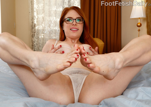 Hot Redhead Wraps Her Sexy Feet Around a Black Cock - Interracial Sexy Photo Gallery