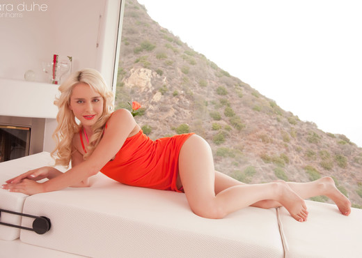 Hot naughty Kara strips her orange dress - Solo Porn Gallery
