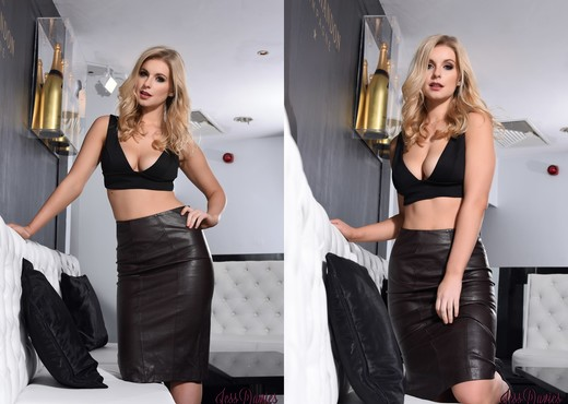 Jess Davies teasing in her black leather skirt and top - Solo HD Gallery