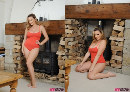 Jodie Gasson teases next to the fire pit in her red bodysuit - Solo Sexy Gallery